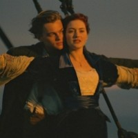 Jack teaching Rose to fly in the front of the Titanic